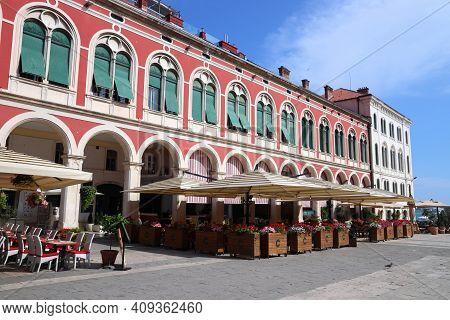 Split, Croatia - July 20, 2019: People Visit Shaded Arcades Of Prokurative Building In Split. Croati
