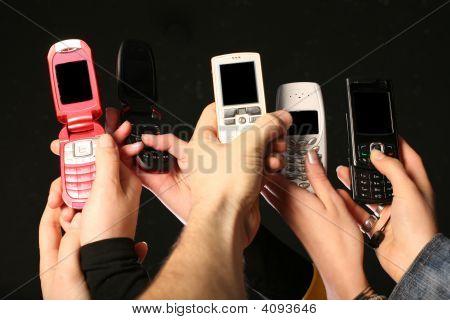 Cell Phones In Hands
