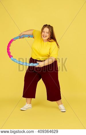 Sports. Beautiful Plump Caucasian Plus Size Model Isolated On Yellow Studio Background. Concept Of I