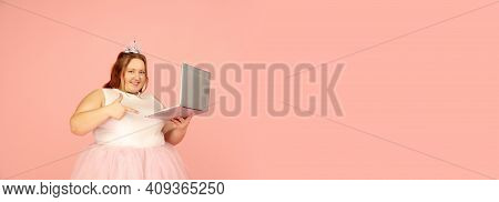 Flyer. Beautiful Plump Caucasian Plus Size Model In Fairys Outfit Isolated On Pink Studio Background