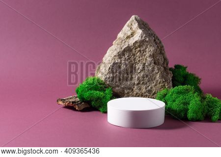 Mockup Podium For Packaging Presentation And Cosmetic. White Pedestal, Natural Stone And Moss On Pur