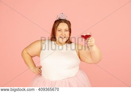 Cheers. Beautiful Plump Caucasian Plus Size Model In Fairys Outfit Isolated On Pink Studio Backgroun