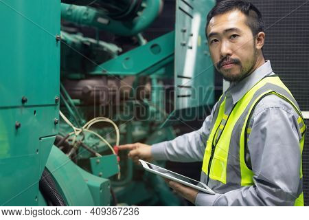 Close Up Hand Of Engineer Or Electrician Man Working Check The Electrical System With Tablet At Fact
