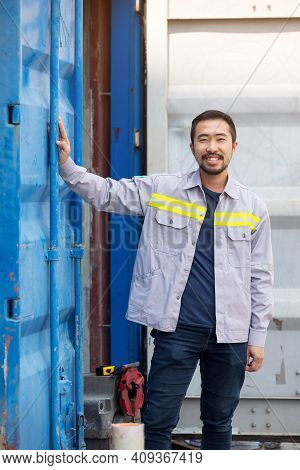 Portrait Of Worker Or Technician Smile And Stand Container