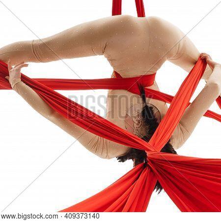Aerialist Doing Acrobatic Tricks On Aerial Silks