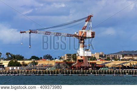 The Elevating Crane Against The Blue Sky.
