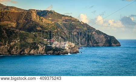 Scenic view of the coasline of Cinque Terre National Park and the village of Manarola