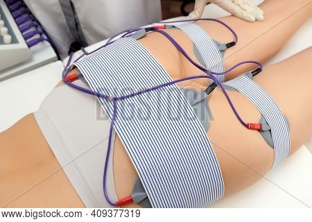 Myostimulation Of The Buttocks And Thighs. Beautician Installs Electrodes To Myostimulation The Butt