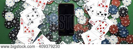 Online Casino, Mobile Casino, Mobile Phone, Chips Cards On A Green Background. Gambling Games. View