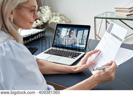 Female Hr Reading Cv During Online Virtual Job Interview By Video Call. Employer Checking African Ma