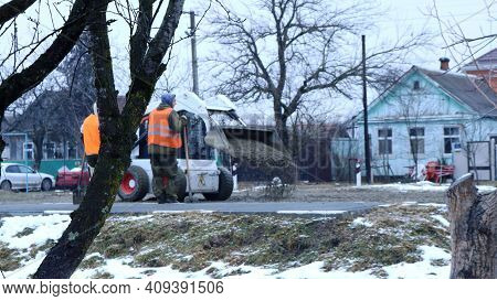 Maykop, Republic Of Adygea, Russia - January 16, 2021: A View From Behind The Trees On A Winter Lawn