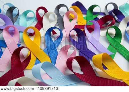 Multi colored cancer ribbon background. Proudly worn by patients, supporters and survivors for world cancer day. Bringing awareness to all types of cancer