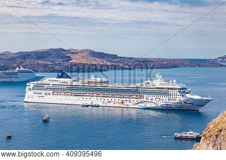 Santorini Island, Cyclades, Greece - May.08.2019: Photo From Famous Norwegian Star Cruise Ship Liner