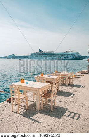 Greece, Santorini. Restaurant With Served Table In Seafront Of Aegean Sea On Santorini Cyclades Isla