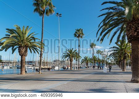 Embankment With Palm Trees And Yachts In Barcelona, Spain - May 13, 2018.