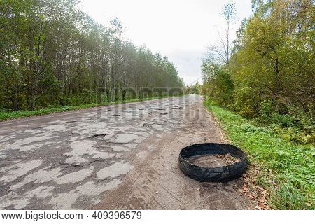 Destroyed Rubber Car Tire Car On Rural Bumpy Broken Road