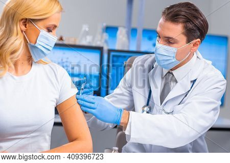 Professional Doctor Makes A Coronavirus Vaccine Using A Syringe And Hypodermic Needle. Professional