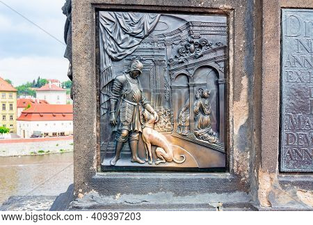 Relief Of Dog Under Statue Of St. John Of Nepomuk On Charles Bridge In Prague, Czech Republic