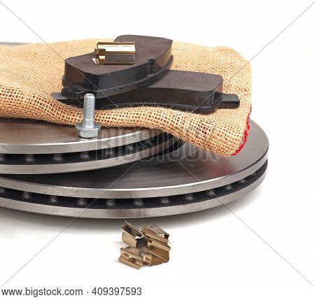 Brake Discs And Brake Pads Isolated On White. Auto Parts