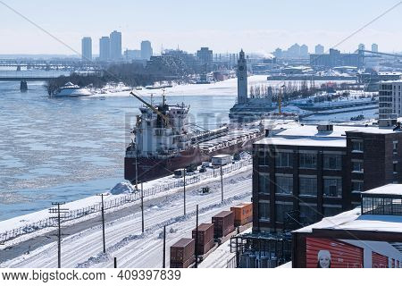 Montreal, Ca - 22 February 2021: View Of Montreal Skyline And Frozen Saint-lawrence River From Jacqu