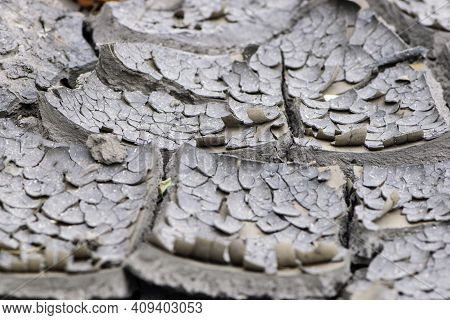 Background Of Cracks In The Soil, Drought, Ecology. Dry Cracked Ground Texture. Desert Background. G