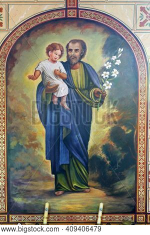 ZABOK, CROATIA - JULY 06, 2013: Saint Joseph holds a child Jesus, Saint Helena Parish Church in Zabok, Croatia