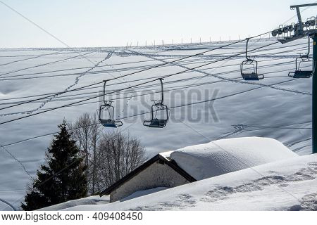 Chairlift And Snow