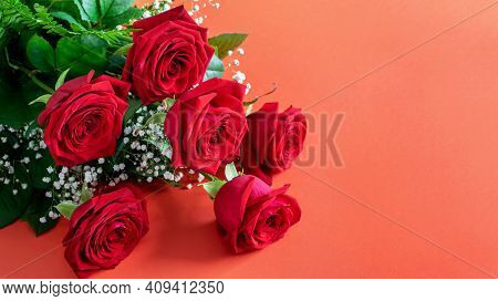 Nice Red Roses Bouquet On The Deep Pink Background Closeup, Banner Photo For Your Text, Invitation.