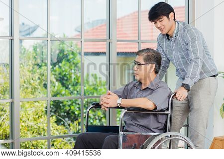 Asian Senior Disabled Businessman In Wheelchair Discuss Interacting Together With The Team In The Of