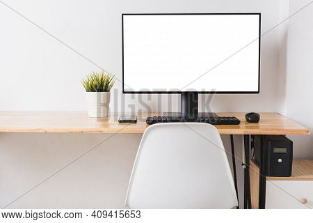 Computer Monitor With White Blank Screen On The Business Desk With Wireless Mouse, Keyboard At Home