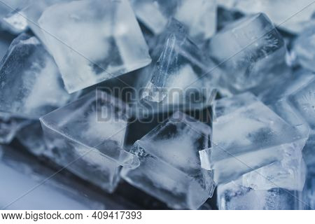 Close-up Of Ice Cubes In Freezer Tray With Cold Blue Tones