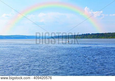 Rainbow Over The Lake . Spectacular Natural Phenomenon
