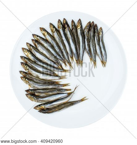 Smoked Herring, Laid Out In A Circle On A White Round Plate. Isolated On A White Background