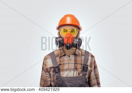 Portrait Of Handyman In Protective Work Equipment Is Looking To The Camera.