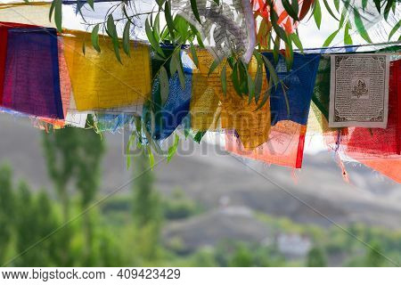 Buddhist Religious Flags Hanging At Mulbekh, Ladakh. Himalayan Mountains In Background, Ladakh, Jamm