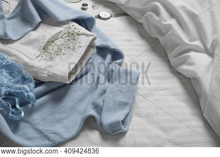 Stylish Look With Cashmere Sweater. Women's Clothes And Accessories On Bed