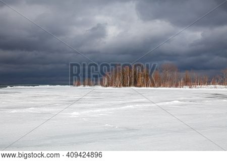 A Winter Storm Approaches The Shores Of Southern Georgian Bay In Lighthouse Point, Collingwood. Ice