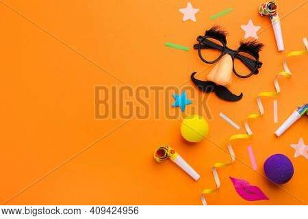 Flat Lay Composition With Clown's Accessories On Orange Background. Space For Text