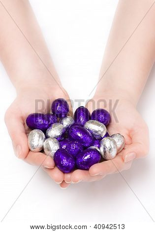 Puple And Silver Easter Eggs In Hands