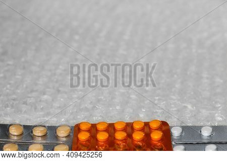 Trendy Modern Minimalistic Background Of Orange Beige White Pills Blister.bubble Bag Background. Pac