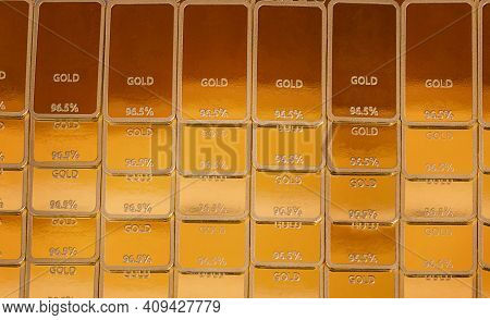 Ingot Gold Background. Gold Bars In Rows