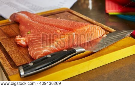 Cooking At Home In The Kitchen According To Recipe From The Internet. Fresh Salmon Ready For Slicing