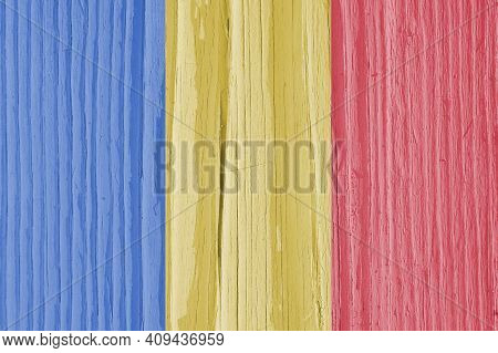 The Flag Of Romania On Dry Wooden Surface, Cracked With Age. Pale Faded Paint. Background, Wallpaper