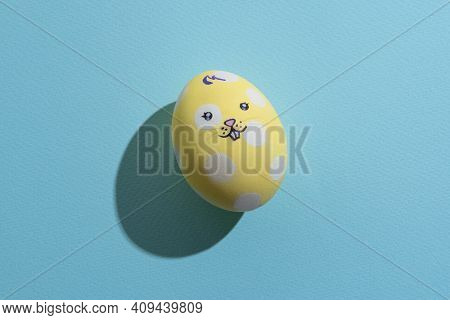 Happy Easter. Funny Bunny Decor. Festive Gift. Holiday Celebration. Colorful Egg Of Yellow White Spo