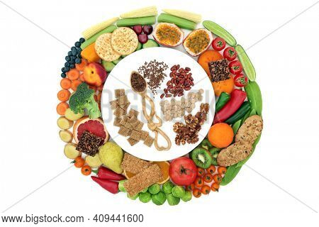 Vegan health whole food high in fibre and good for digestive health. On a plate in a circle on white. High in antioxidants, minerals, vitamins, anthocyanins, omega 3, protein and smart carbs.