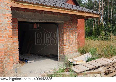 Garage Door Installation: Attaching The Door Panels Into The Garage Door Opening In A New Built Bric
