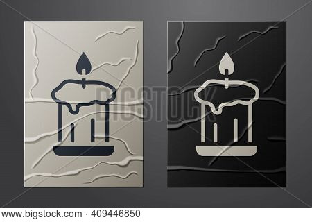 White Burning Candle In Candlestick Icon Isolated On Crumpled Paper Background. Old Fashioned Lit Ca