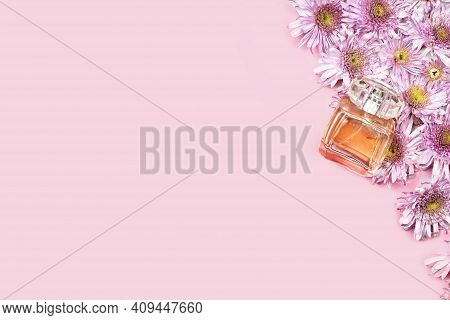 Fresh Spring Flowers And Perfume. Pink Background For Advertising Fragrance For Women. Bridal Perfum