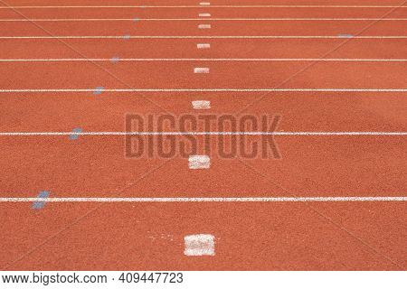 The Striped Lane In Running Track Or Athlete Track In Stadium. Running Track Is A Rubberized Artific