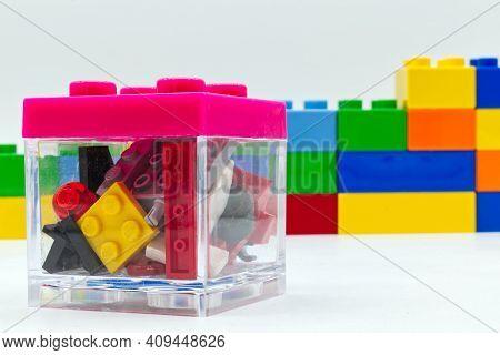 Bologna - Italy - February 21, 2021: Mixed Lego Building Blocks Inside A Transparent Lego Box.